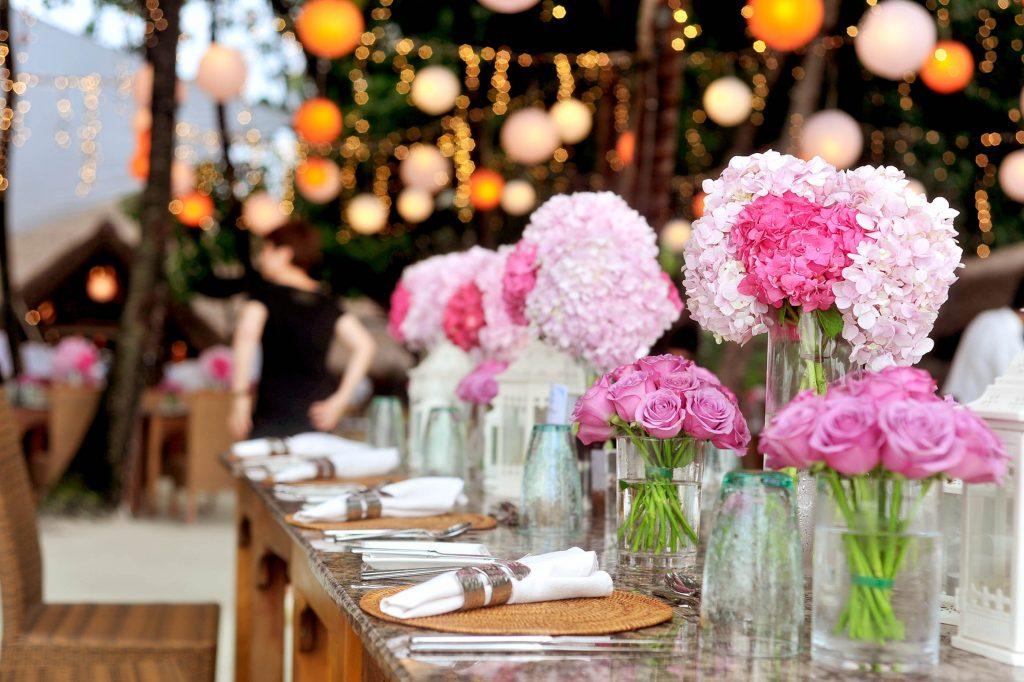 A close up of a floral table wedding arrangement