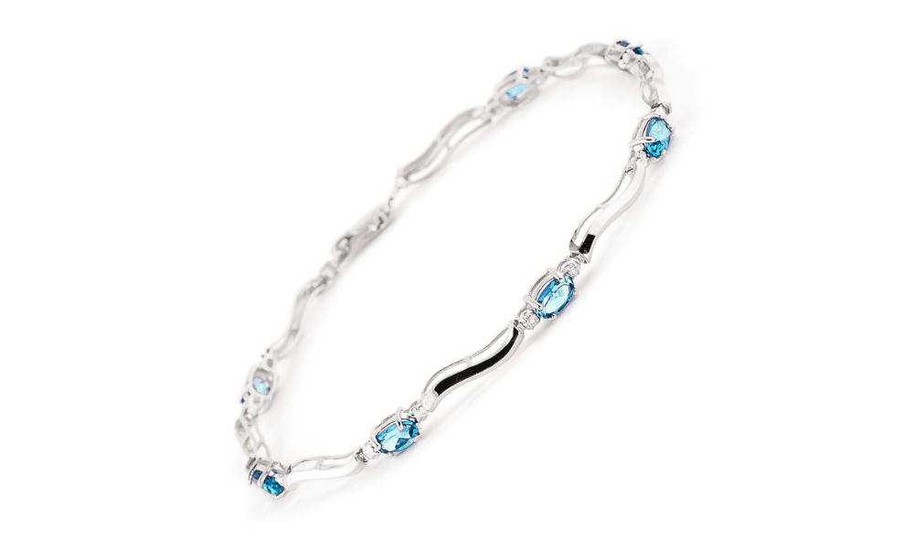 Blue Topaz & Diamond Classic Tennis Bracelet in 9ct White Gold